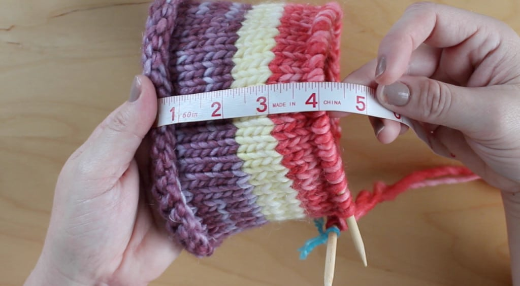 Measuring tape of four inches with striped knitted nest