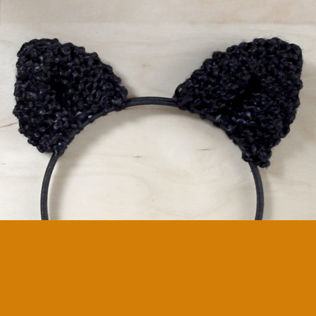 Knitted Cat Ears on a headband in black color yarn.