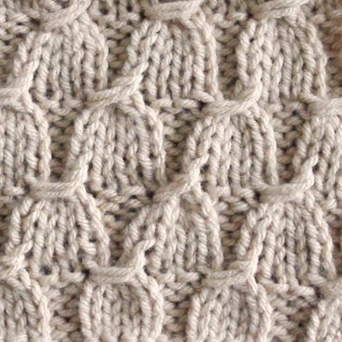 Tassel Stitch Knitting Pattern in Beige color yarn.
