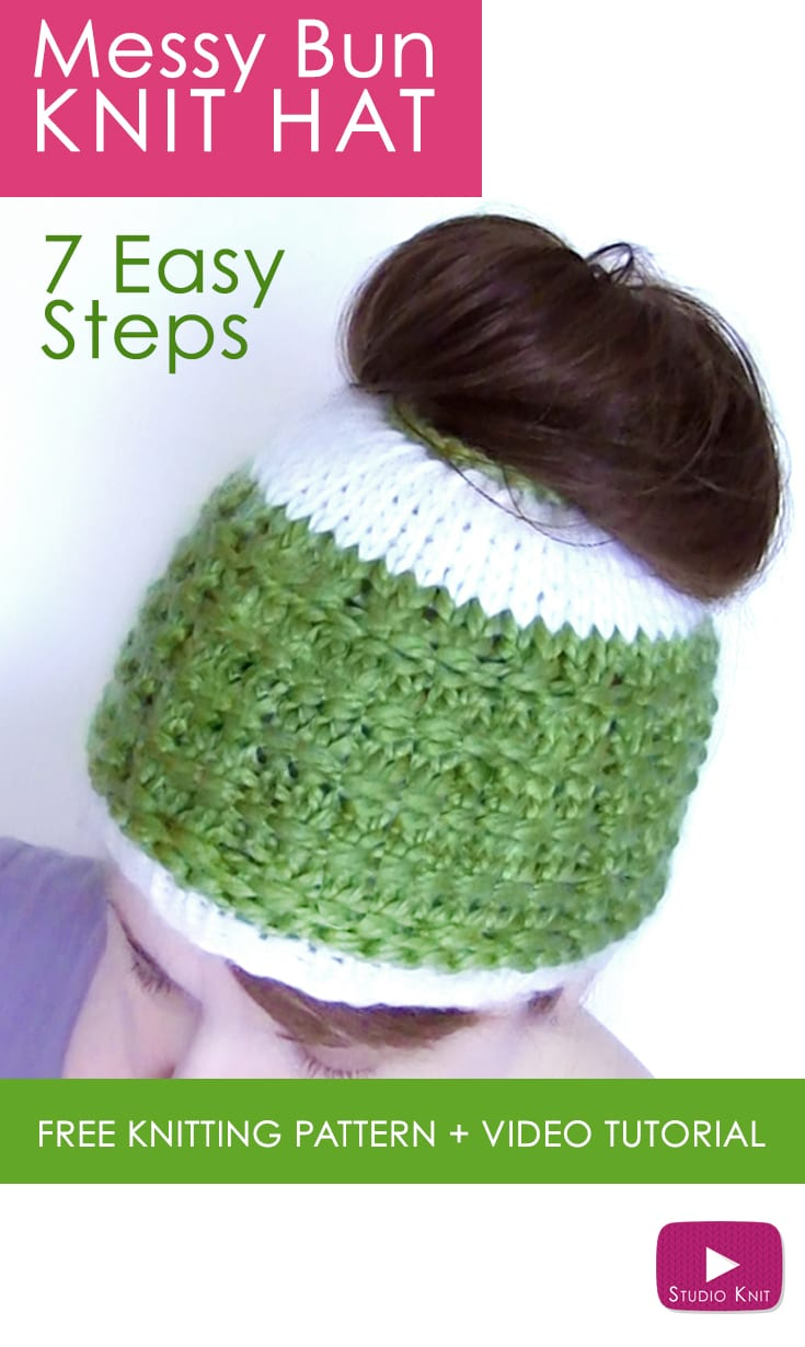 A woman wearing a knitted messy bun hat in green and white yarn colors