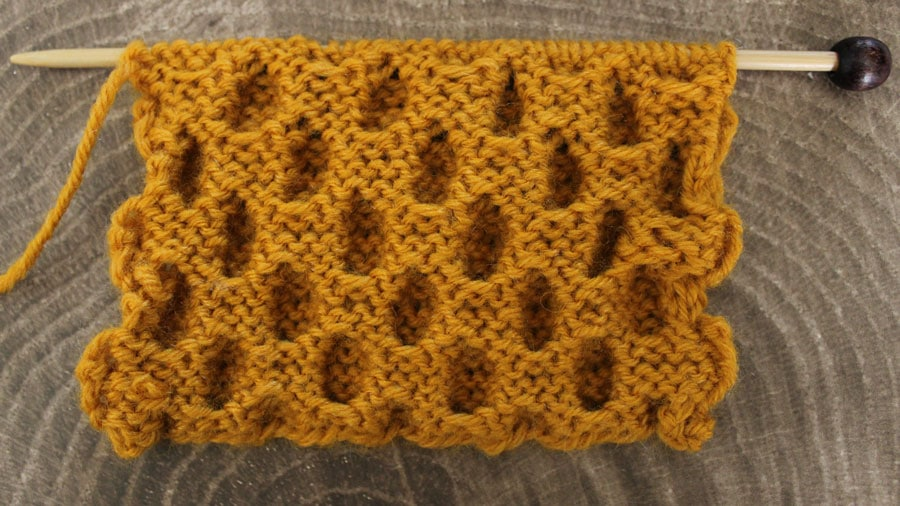 Wrong Side - How to Knit the Honeycomb Cable Stitch with Free Written Pattern and Video Tutorial by Studio Knit. #knitstitchpattern #studioknit