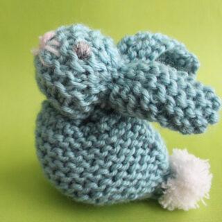 knitted bunny softie in blue yarn