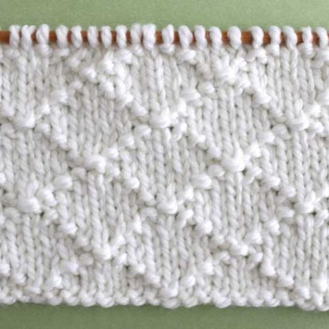 This Diamond Brocade Knit Stitch Pattern is an elegant design created by a simple series of knits and purls.