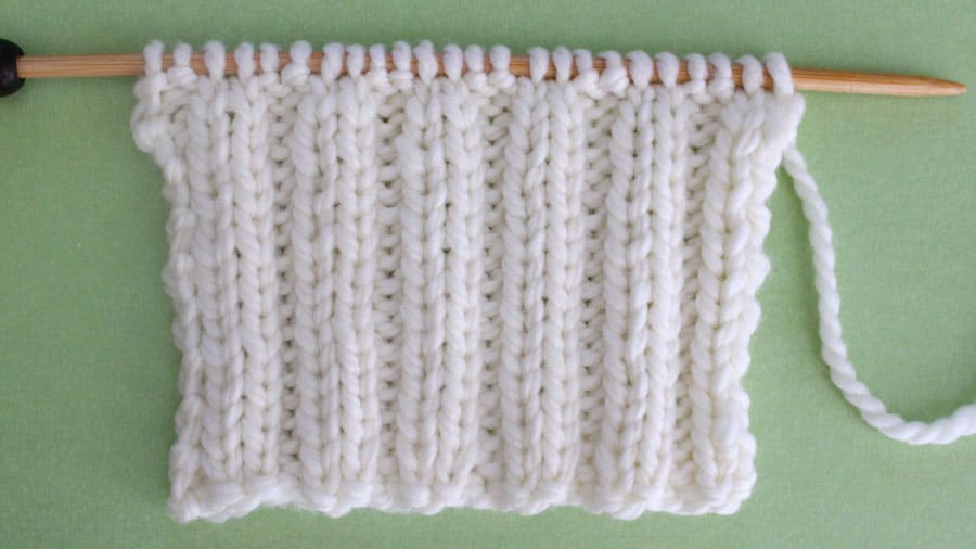2x2 Rib Knit Stitch Pattern. Get Free Written Patterns, Charts, and Video Tutorials in the Absolute Beginner Knitting Series by Studio Knit.