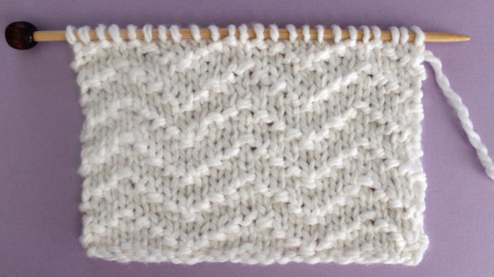 Chevron Seed Knit Stitch Pattern. Get Free Written Patterns, Charts, and Video Tutorials in the Absolute Beginner Knitting Series by Studio Knit.