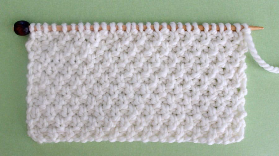 Irish Moss Knit Stitch Pattern. Get Free Written Patterns, Charts, and Video Tutorials in the Absolute Beginner Knitting Series by Studio Knit.