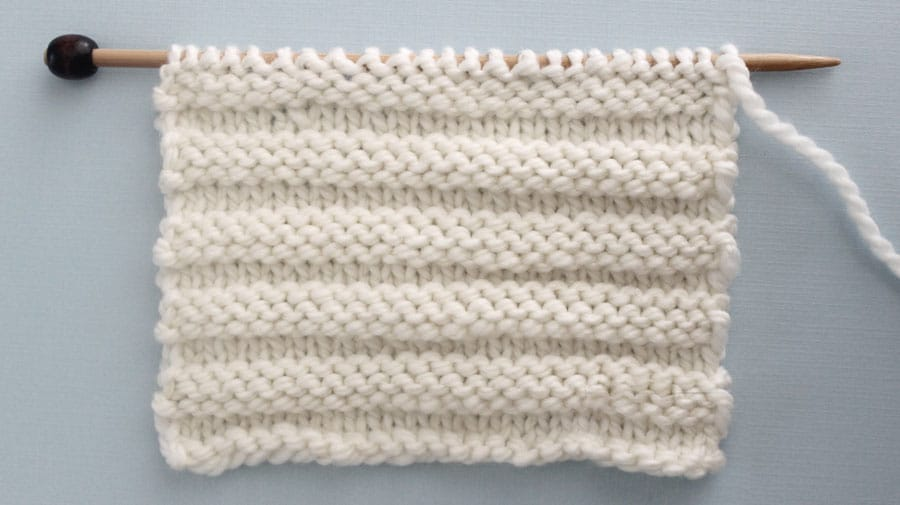 Reverse Ridge Knit Stitch Pattern. Get Free Written Patterns, Charts, and Video Tutorials in the Absolute Beginner Knitting Series by Studio Knit.