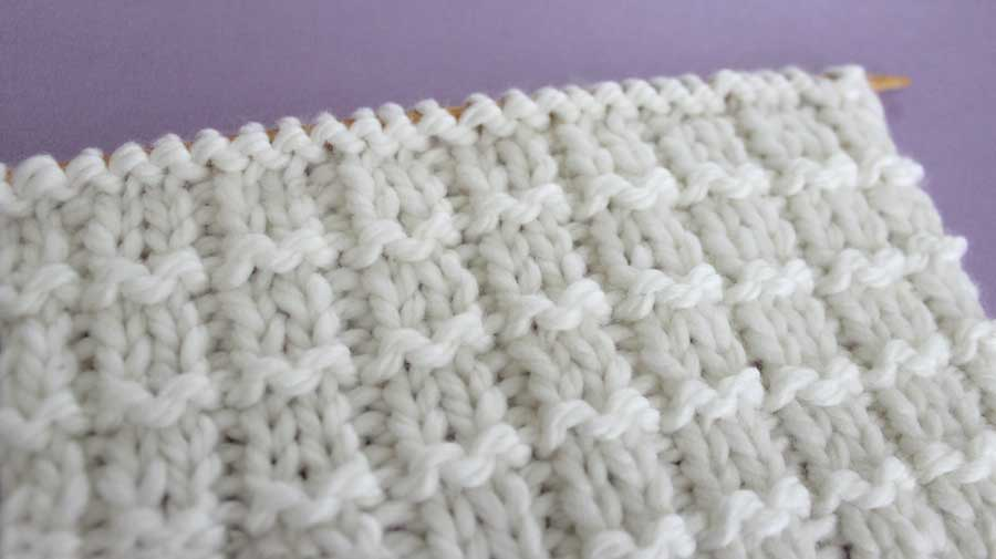 Side View of Pique Rib Knit Stitch Pattern by Studio Knit with Free Pattern and Video Tutorial