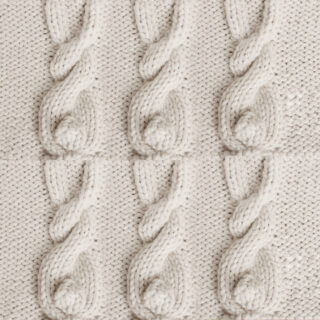 Six Knitted Bunny Cable Patterns in beige color yarn.