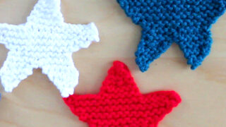 3 Knitted Star Shapes in red, white, and blue yarn colors.