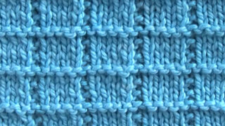 Knitted swatch in Tile Squares texture with blue colored yarn.