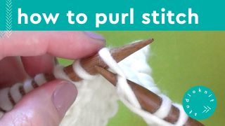 Close up of purl stitch in knitting with yarn and needels