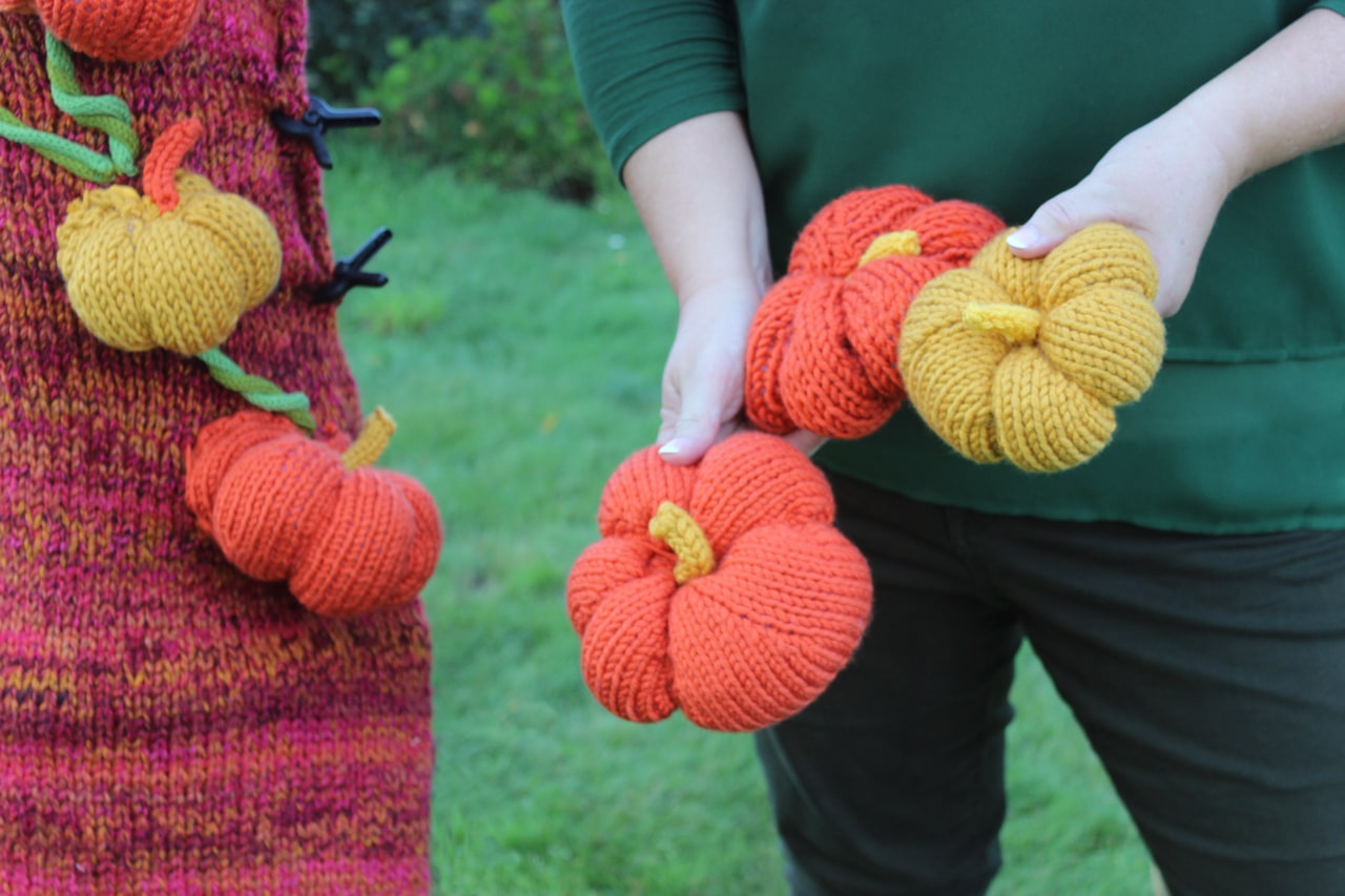 Hand knit pumpkins by Studio Knit for yarnbomb art installation in Salesforce Park