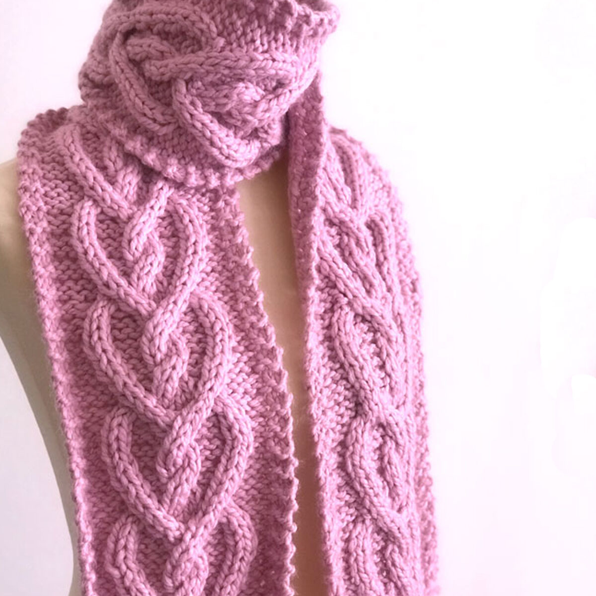 Heart Cable Knit Scarf in Pink Wool Yarn on Dress Form