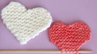 Two knitted hearts in garter stitch.