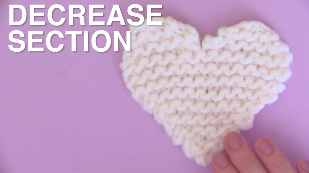White knitted heart decrease section