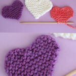 4 knitted hearts with knitting needle