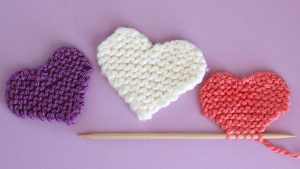 three knitted hearts in garter stitch