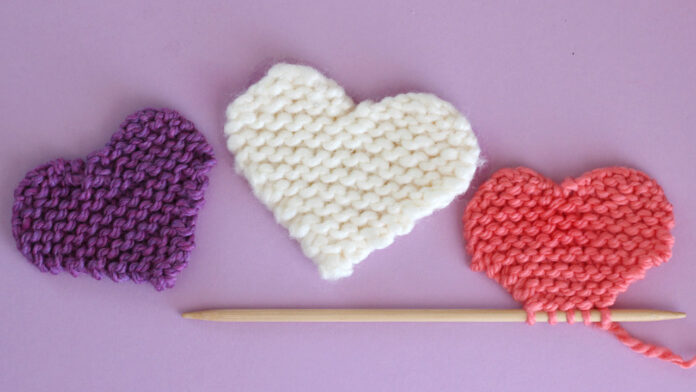 three knitted hearts in garter stitch