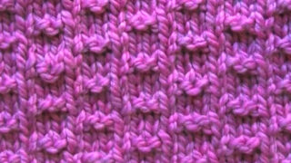 Double Fleck Knitting Pattern in Purple Yarn