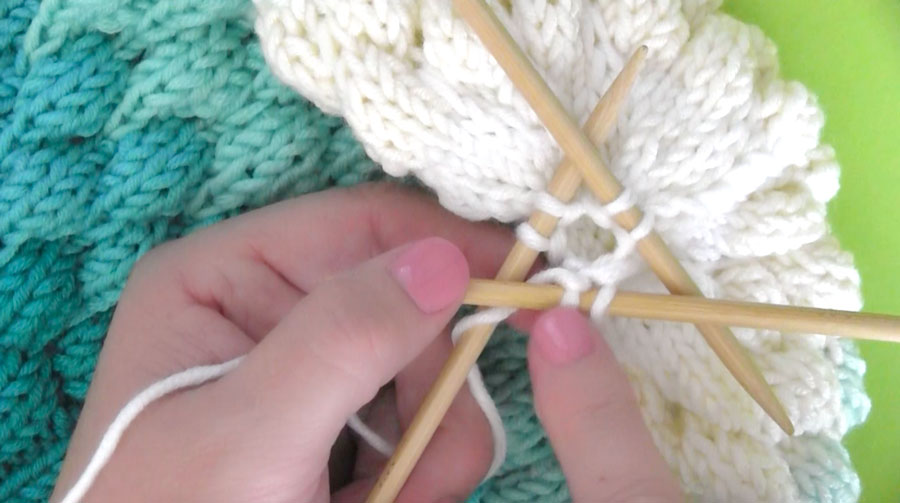 Decreasing Bubble Beanie Hat crown on three double-pointed needles.