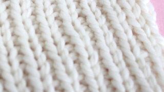 1x1 Rib Knit Stitch Pattern in white color yarn on knitting needle.