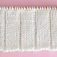 Knit 5x1 Rib Stitch Pattern with white color yarn on straight knitting needle.