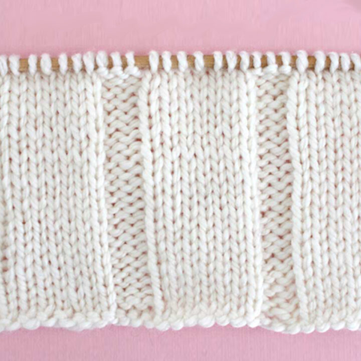 7x3 Rib Knit Stitch Pattern in white yarn on knitting needle.