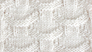 Knit Basket Loop Stitch Pattern with white color yarn on straight knitting needle.