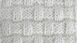 Basket Weave Stitch Knitting Pattern in white yarn color on knitting needle.