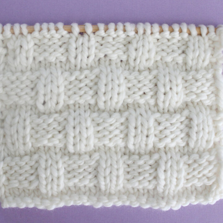 Basket Weave Stitch Knitting Pattern in white yarn color on knitting needle.