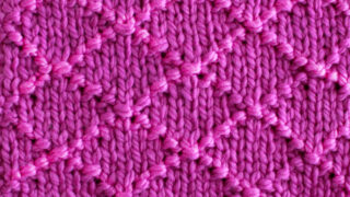 Diamond Brocade Knit Stitch Pattern texture in purple color yarn.