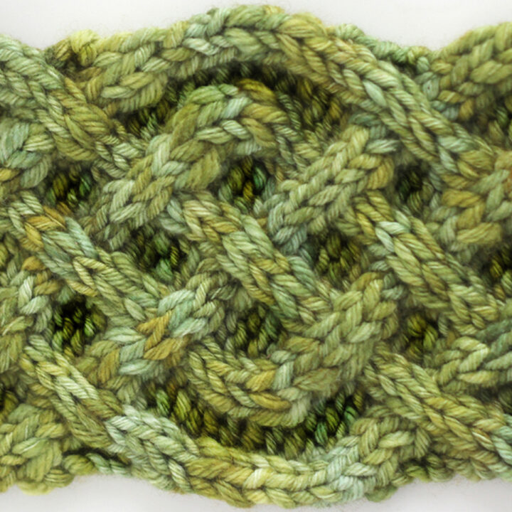 Celtic Saxon Cable Knit Stitch Pattern in green color yarn.