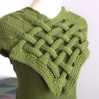 Celtic Saxon Braided Scarf in green yarn on mannequin.