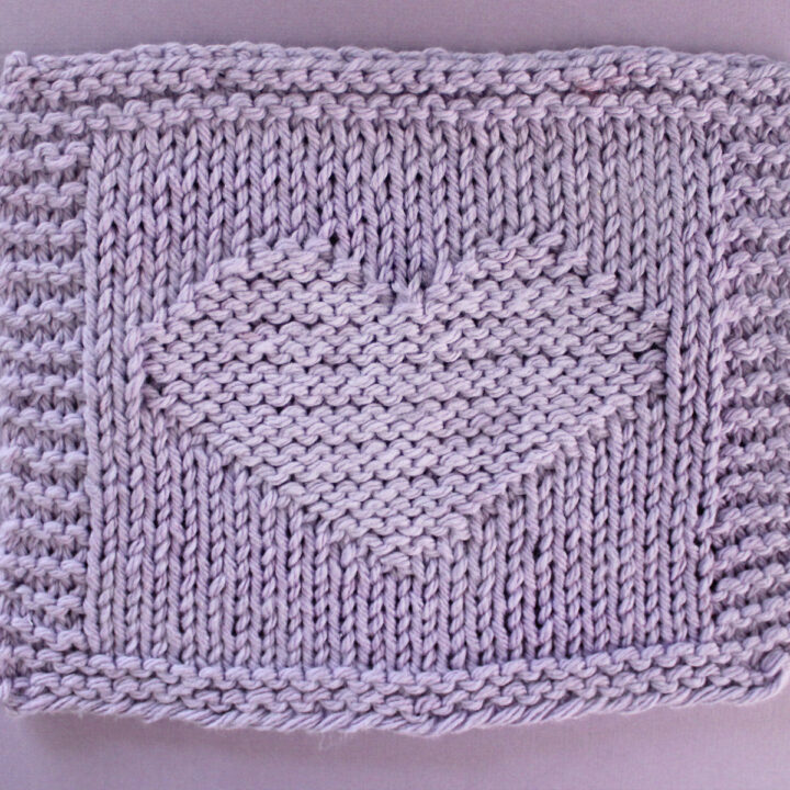 Heart Stitch Knitting Pattern in purple yarn color for dishcloth.