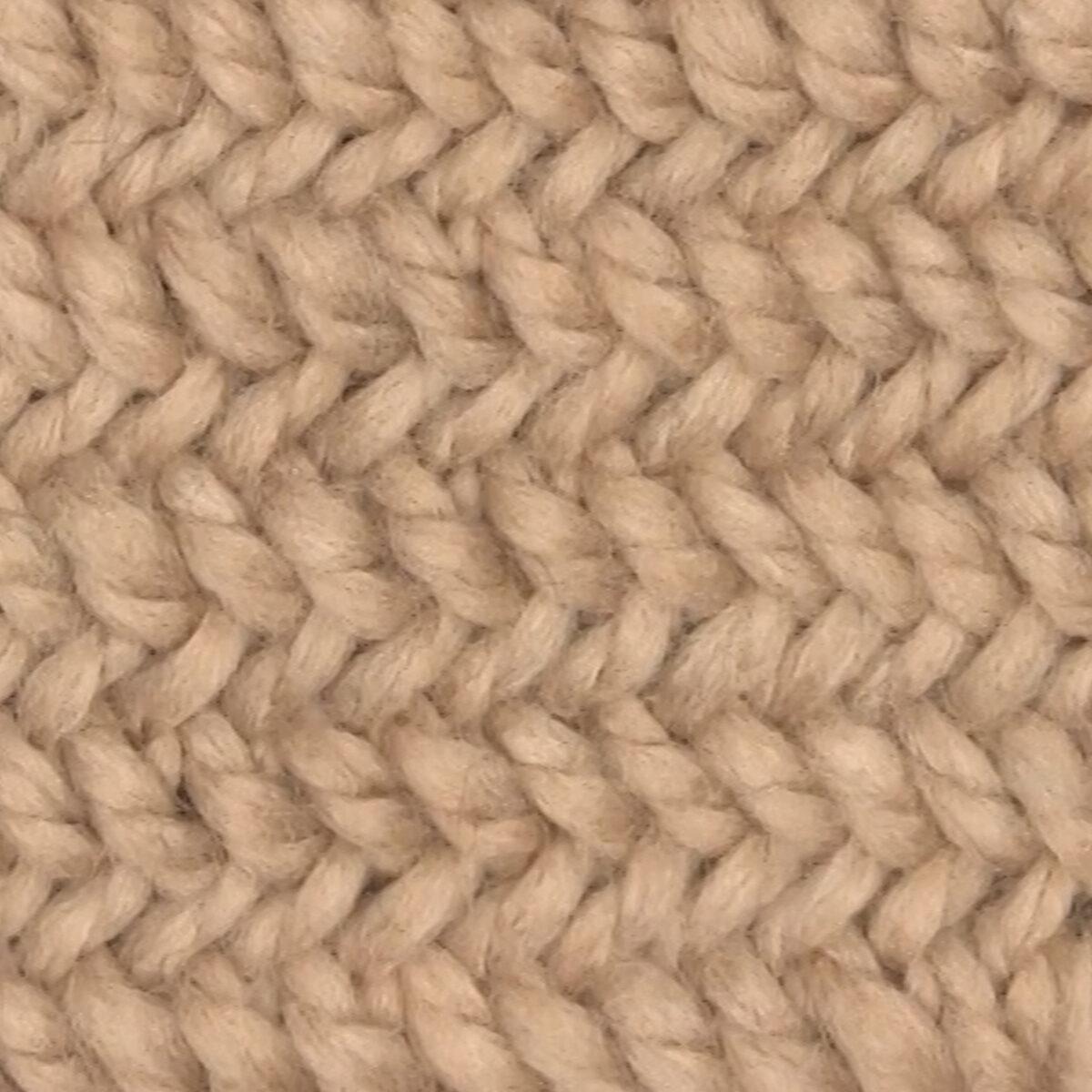 Knitted Herringbone Stitch Pattern texture in beige color yarn.
