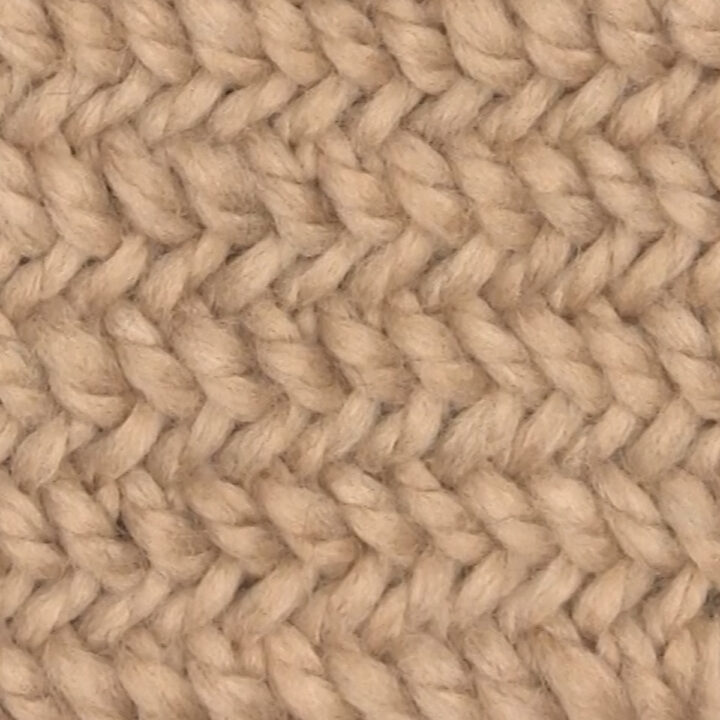Knitted Herringbone Stitch Pattern texture in beige color yarn.