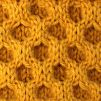 Honeycomb Cable Knit Stitch Pattern in gold yarn color.