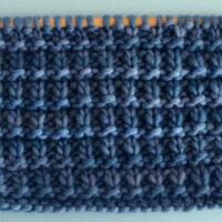 Hurdle Basket Weave Stitch Knitting Pattern in blue yarn color on knitting needle.