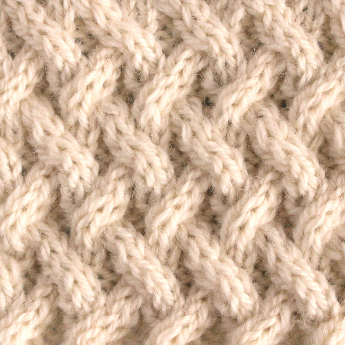 Lattice Cable Knit Stitch Pattern texture in beige color yarn.
