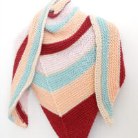 Knitted Striped Shawl with horizontal stripes in burgandy, peach, light blue, pink, and white yarn colors.
