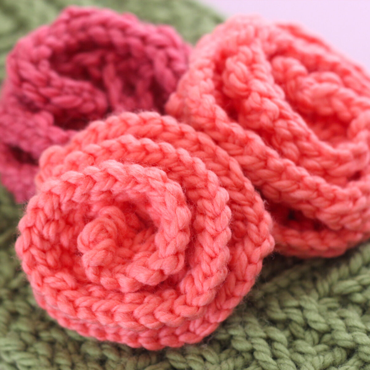 Knitted Rose shapes in peach and pink color yarn