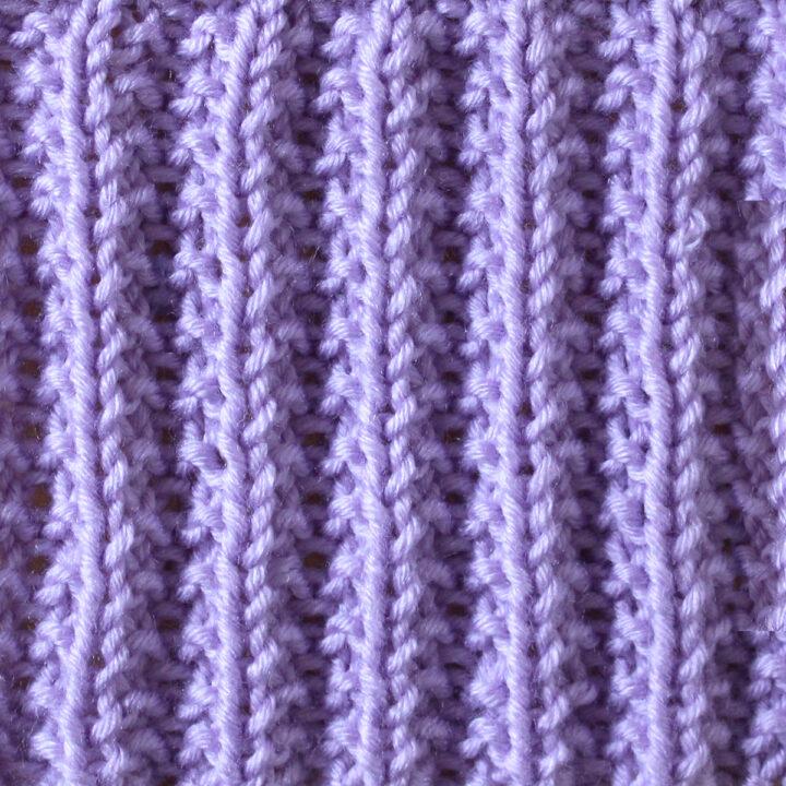 Seeded Rib Knit Stitch Pattern in purple yarn.