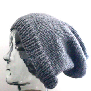 Slouchy Knitted Beanie Hat in Gray color yarn on mannequin head