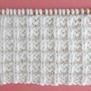Waffle Stitch Knitting Pattern in white yarn color on knitting needle.