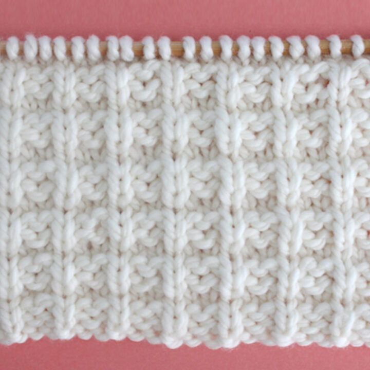 Waffle Stitch Knitting Pattern in white yarn color on knitting needle.