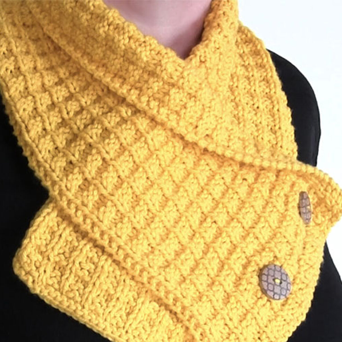 Knitted Waffe Stitch Neck Warmer Scarf in yellow yarn color.