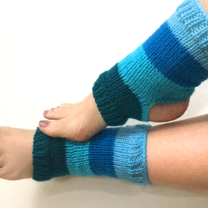Knitted Yoga Socks on two feet in blue yarn colors.