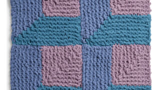 Knitted Square in the Attic Windows Design with shades of blue and purple yarn colors.