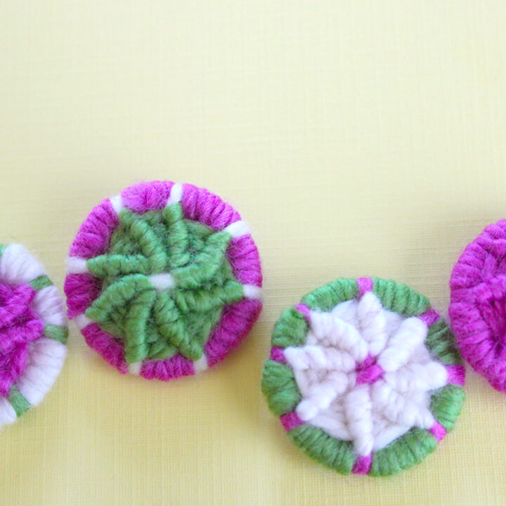 Dorset Buttons in white, green, and pink color yarn.